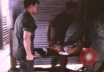 Image of wounded United States soldier Vietnam, 1969, second 34 stock footage video 65675022611