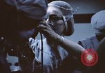 Image of wounded United States soldier Vietnam, 1969, second 45 stock footage video 65675022611