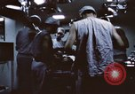 Image of wounded United States soldier Vietnam, 1969, second 57 stock footage video 65675022611