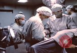Image of wounded United States soldier Vietnam, 1969, second 8 stock footage video 65675022612