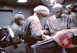 Image of wounded United States soldier Vietnam, 1969, second 9 stock footage video 65675022612