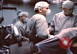 Image of wounded United States soldier Vietnam, 1969, second 28 stock footage video 65675022612