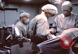 Image of wounded United States soldier Vietnam, 1969, second 32 stock footage video 65675022612