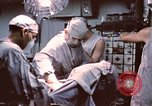 Image of wounded United States soldier Vietnam, 1969, second 42 stock footage video 65675022612