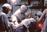 Image of wounded United States soldier Vietnam, 1969, second 45 stock footage video 65675022612