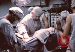 Image of wounded United States soldier Vietnam, 1969, second 47 stock footage video 65675022612