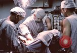 Image of wounded United States soldier Vietnam, 1969, second 51 stock footage video 65675022612