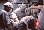 Image of wounded United States soldier Vietnam, 1969, second 53 stock footage video 65675022612