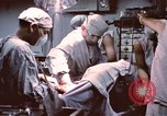Image of wounded United States soldier Vietnam, 1969, second 54 stock footage video 65675022612