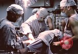 Image of wounded United States soldier Vietnam, 1969, second 56 stock footage video 65675022612