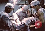 Image of wounded United States soldier Vietnam, 1969, second 58 stock footage video 65675022612