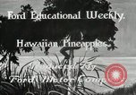 Image of Hawaiian pineapple workers resting Hawaii USA, 1916, second 3 stock footage video 65675022621