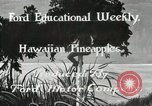 Image of Hawaiian pineapple workers resting Hawaii USA, 1916, second 5 stock footage video 65675022621