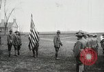 Image of US Army troops and band marching with flag during training United States USA, 1916, second 8 stock footage video 65675022632