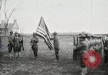 Image of US Army troops and band marching with flag during training United States USA, 1916, second 11 stock footage video 65675022632