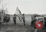 Image of US Army troops and band marching with flag during training United States USA, 1916, second 12 stock footage video 65675022632