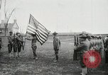 Image of US Army troops and band marching with flag during training United States USA, 1916, second 14 stock footage video 65675022632