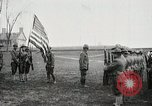 Image of US Army troops and band marching with flag during training United States USA, 1916, second 15 stock footage video 65675022632