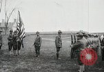 Image of US Army troops and band marching with flag during training United States USA, 1916, second 16 stock footage video 65675022632