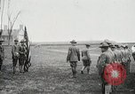 Image of US Army troops and band marching with flag during training United States USA, 1916, second 19 stock footage video 65675022632