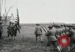 Image of US Army troops and band marching with flag during training United States USA, 1916, second 21 stock footage video 65675022632