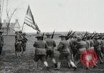 Image of US Army troops and band marching with flag during training United States USA, 1916, second 22 stock footage video 65675022632