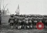 Image of US Army troops and band marching with flag during training United States USA, 1916, second 23 stock footage video 65675022632