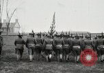 Image of US Army troops and band marching with flag during training United States USA, 1916, second 24 stock footage video 65675022632