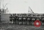 Image of US Army troops and band marching with flag during training United States USA, 1916, second 25 stock footage video 65675022632