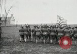 Image of US Army troops and band marching with flag during training United States USA, 1916, second 26 stock footage video 65675022632