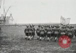 Image of US Army troops and band marching with flag during training United States USA, 1916, second 28 stock footage video 65675022632