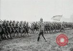 Image of US Army troops and band marching with flag during training United States USA, 1916, second 44 stock footage video 65675022632