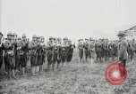 Image of US Army troops and band marching with flag during training United States USA, 1916, second 46 stock footage video 65675022632
