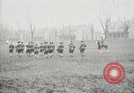 Image of US Army troops and band marching with flag during training United States USA, 1916, second 59 stock footage video 65675022632