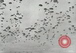 Image of Massive air drop by 187th Airborne Regimental Combat Team Korea, 1951, second 8 stock footage video 65675022693
