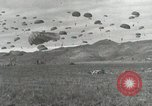 Image of Massive air drop by 187th Airborne Regimental Combat Team Korea, 1951, second 32 stock footage video 65675022693