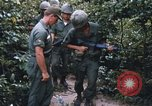 Image of 25th Infantry Division soldiers Vietnam Cu Chi, 1967, second 56 stock footage video 65675022783