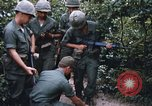 Image of 25th Infantry Division soldiers Vietnam Cu Chi, 1967, second 62 stock footage video 65675022783