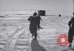 Image of Man distributes goods from container Sierra Greenland, 1954, second 9 stock footage video 65675022806