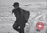Image of Man distributes goods from container Sierra Greenland, 1954, second 11 stock footage video 65675022806