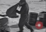 Image of Man distributes goods from container Sierra Greenland, 1954, second 13 stock footage video 65675022806