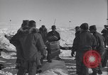 Image of Man distributes goods from container Sierra Greenland, 1954, second 16 stock footage video 65675022806