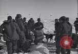 Image of Man distributes goods from container Sierra Greenland, 1954, second 17 stock footage video 65675022806