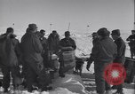 Image of Man distributes goods from container Sierra Greenland, 1954, second 18 stock footage video 65675022806