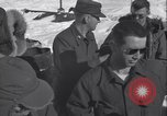 Image of Man distributes goods from container Sierra Greenland, 1954, second 26 stock footage video 65675022806