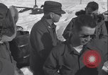 Image of Man distributes goods from container Sierra Greenland, 1954, second 27 stock footage video 65675022806