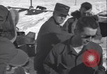 Image of Man distributes goods from container Sierra Greenland, 1954, second 28 stock footage video 65675022806