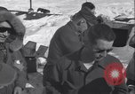 Image of Man distributes goods from container Sierra Greenland, 1954, second 29 stock footage video 65675022806