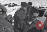 Image of Man distributes goods from container Sierra Greenland, 1954, second 30 stock footage video 65675022806
