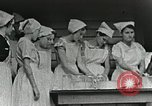 Image of pickling demonstration Campbell County Tennessee USA, 1935, second 29 stock footage video 65675023120